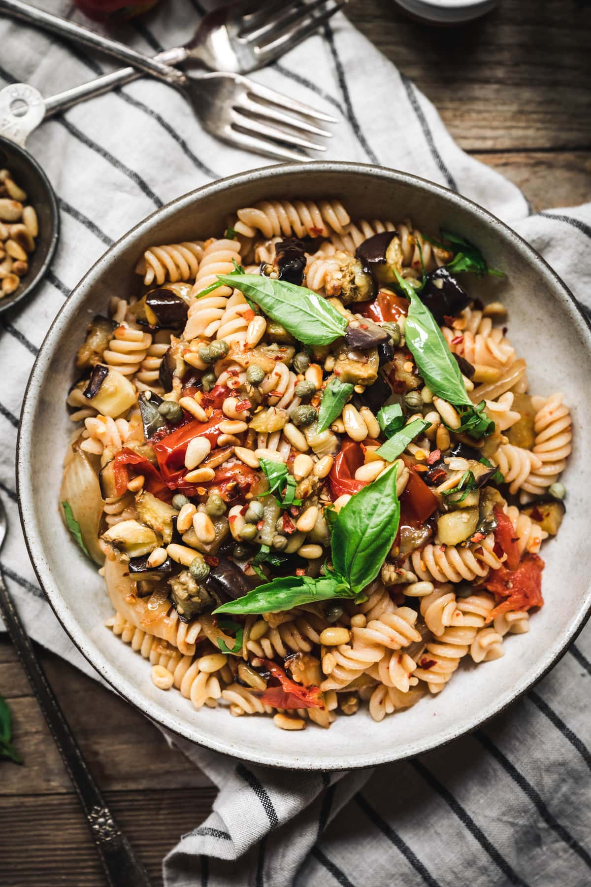 overhead of roasted eggplant tomato pasta in a bowl