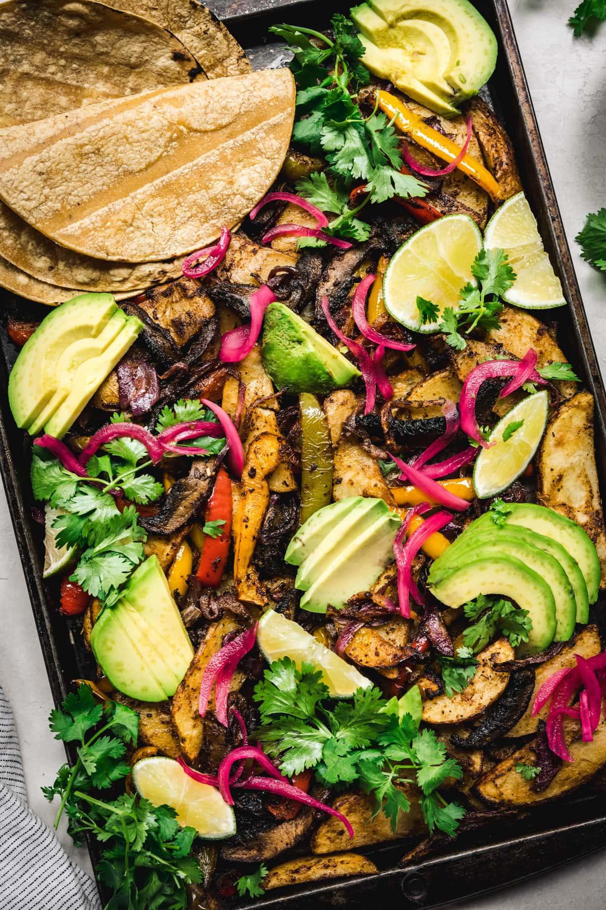 overhead of a full sheetpan of vegan portobello fajitas