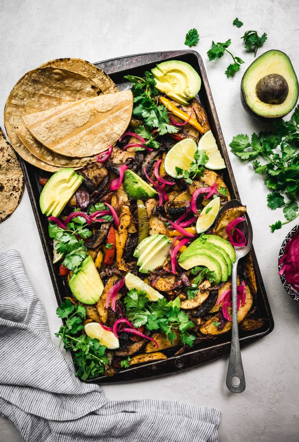 overhead of vegan portobello sheet pan fajitas with corn tortillas