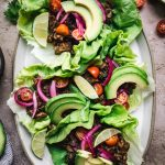 overhead of vegan lentil taco lettuce wraps on an oval platter