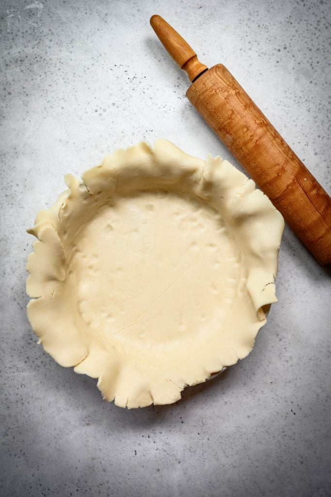 overhead view of vegan gluten free pie crust rolled out in pie pan