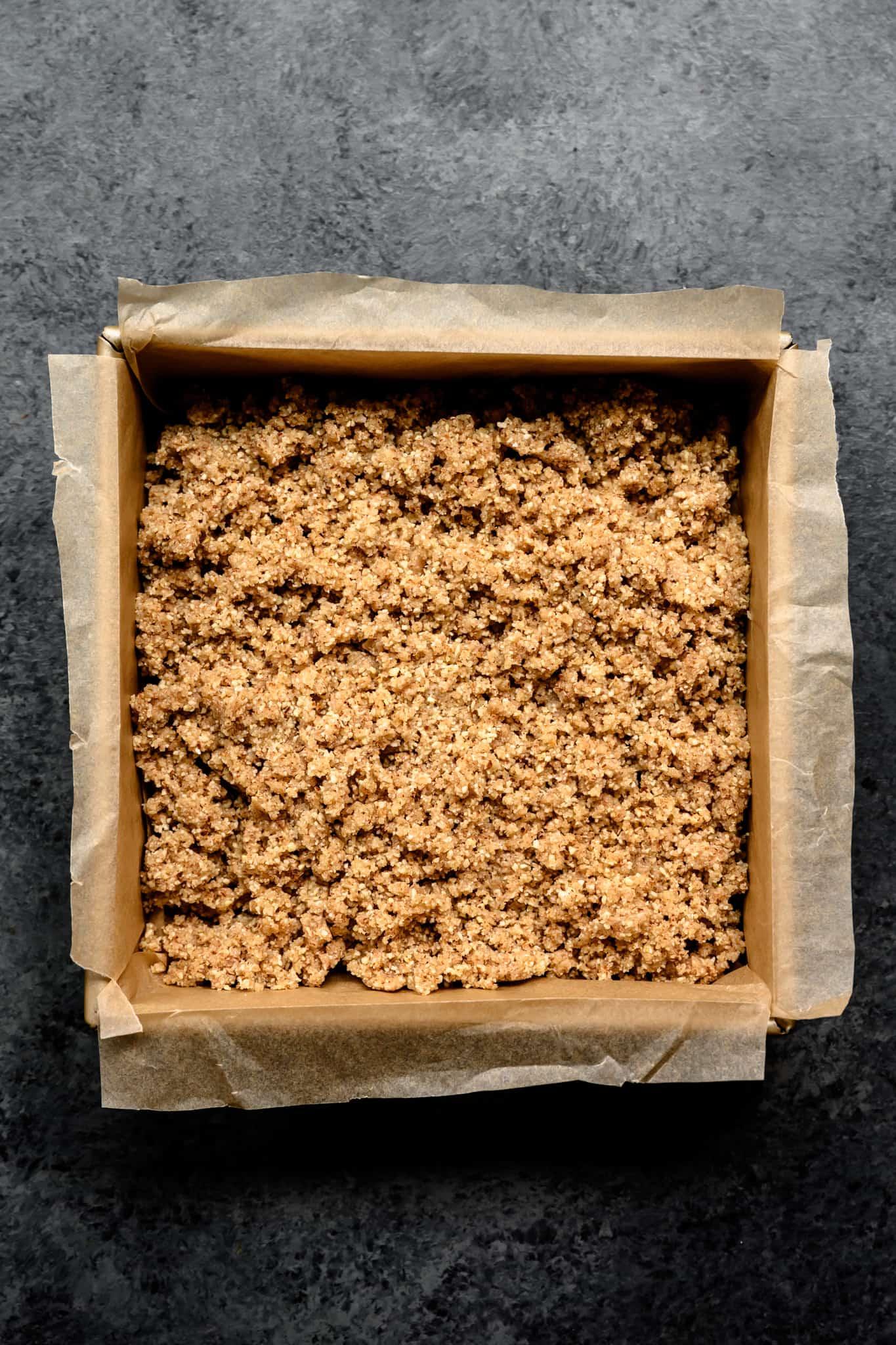 overhead of almond joy filling in a baking sheet