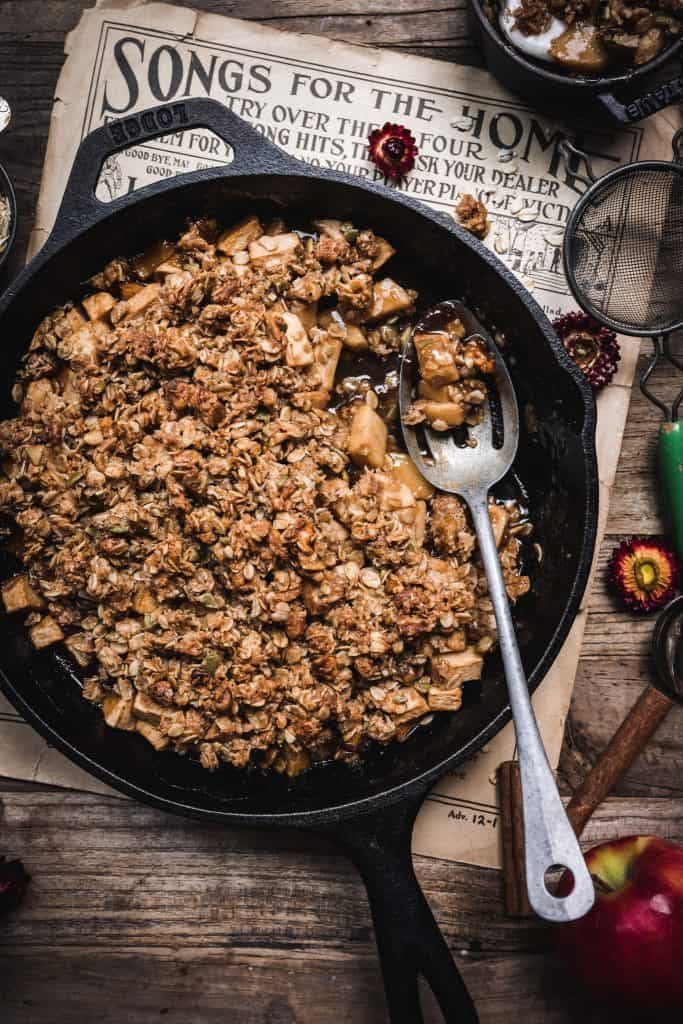overhead of large apple crisp in a cast iron serving pan