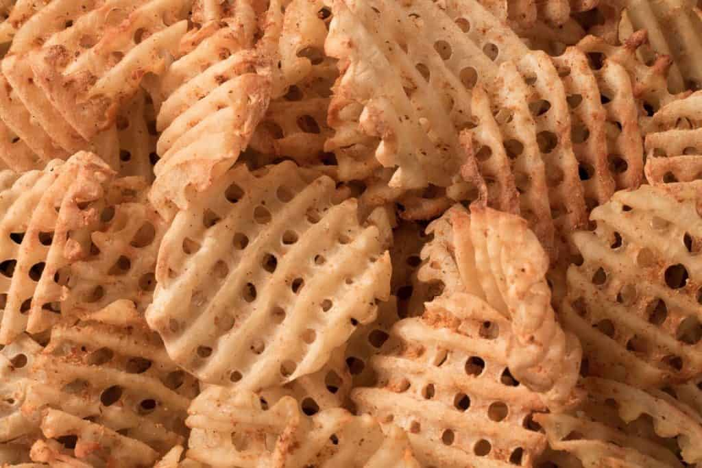 close up of seasoned waffle fries