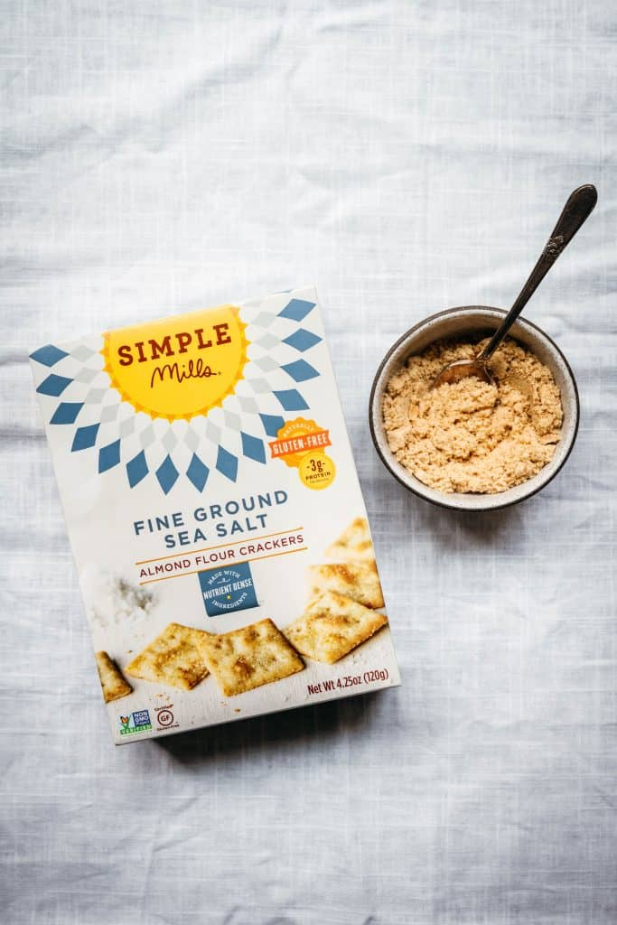 overhead view of simple mills almond flour crackers on white background