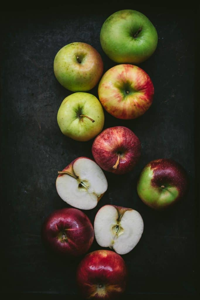 beautiful photography of multi-colored apples on a dark background