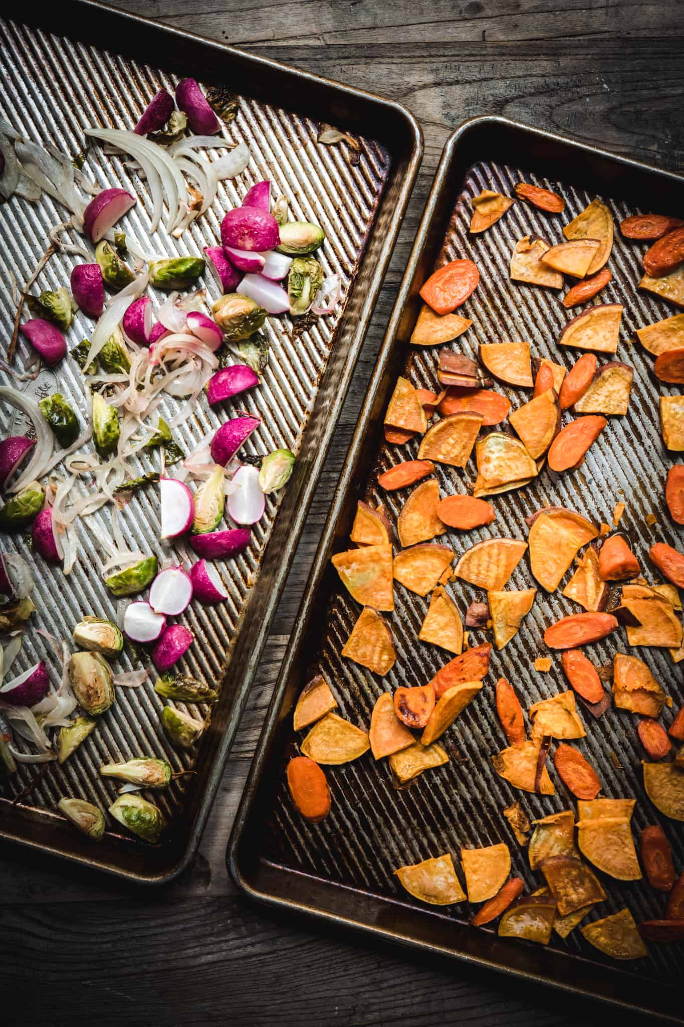 overhead of two sheetpans with roasted vegetables for harvest salad