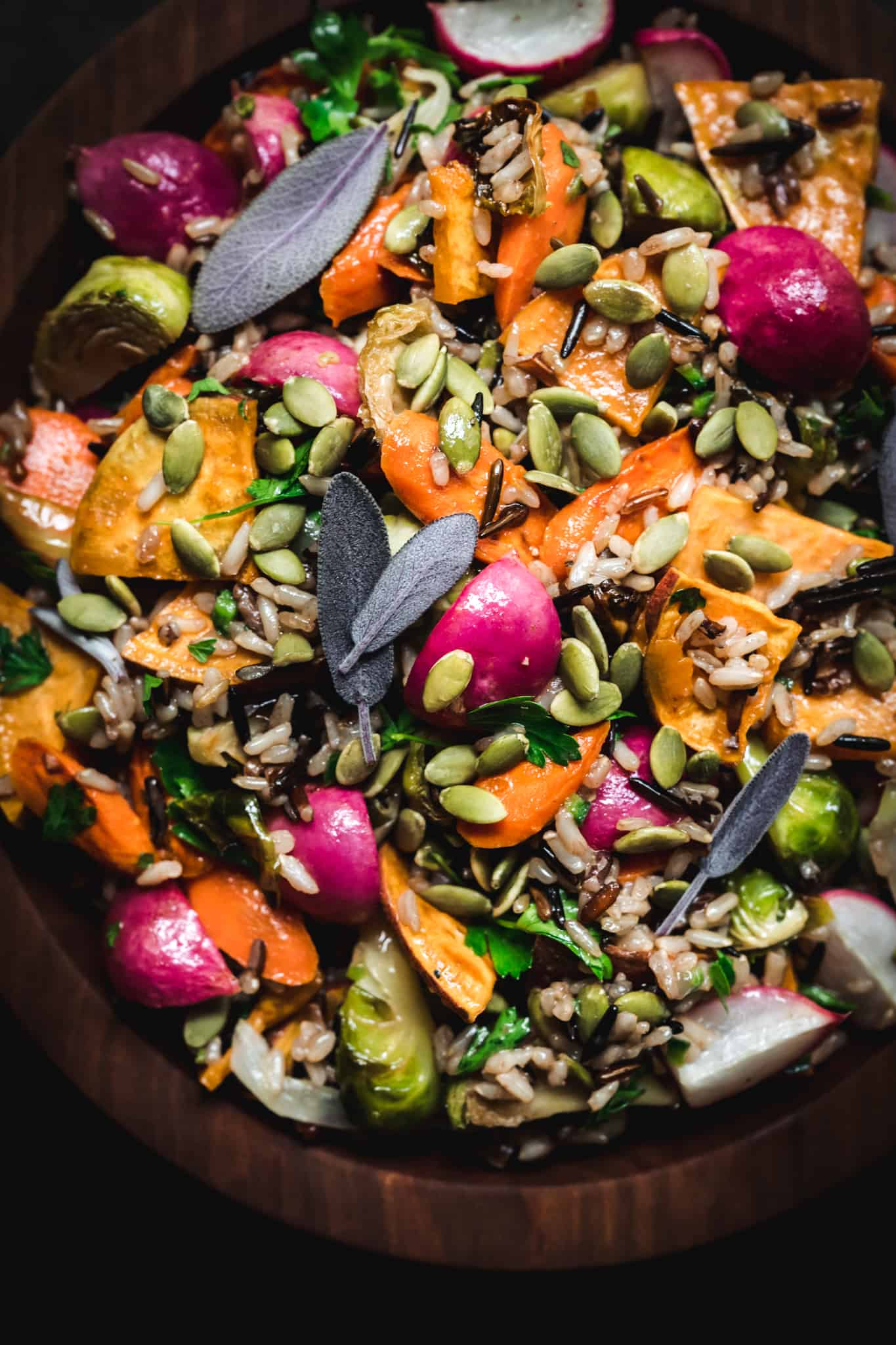 overhead of fall harvest salad with wild rice and roasted vegetables
