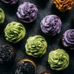 overhead of vegan gluten free cupcakes with frosting colored with natural food coloring