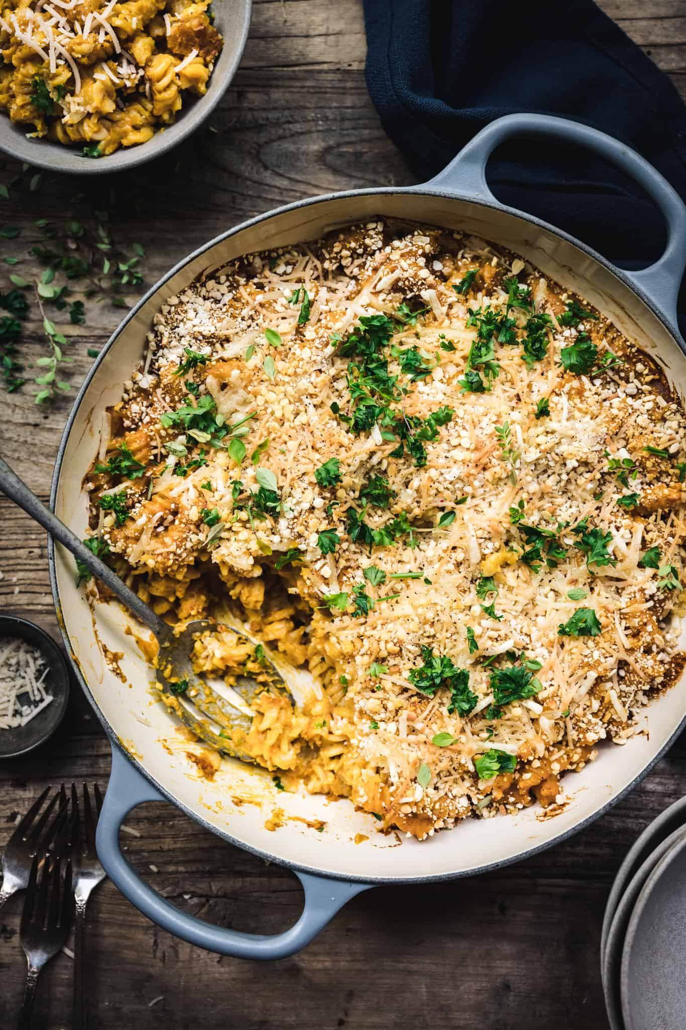 overhead of a baking dish with vegan nut free macaroni and cheese with a spoon