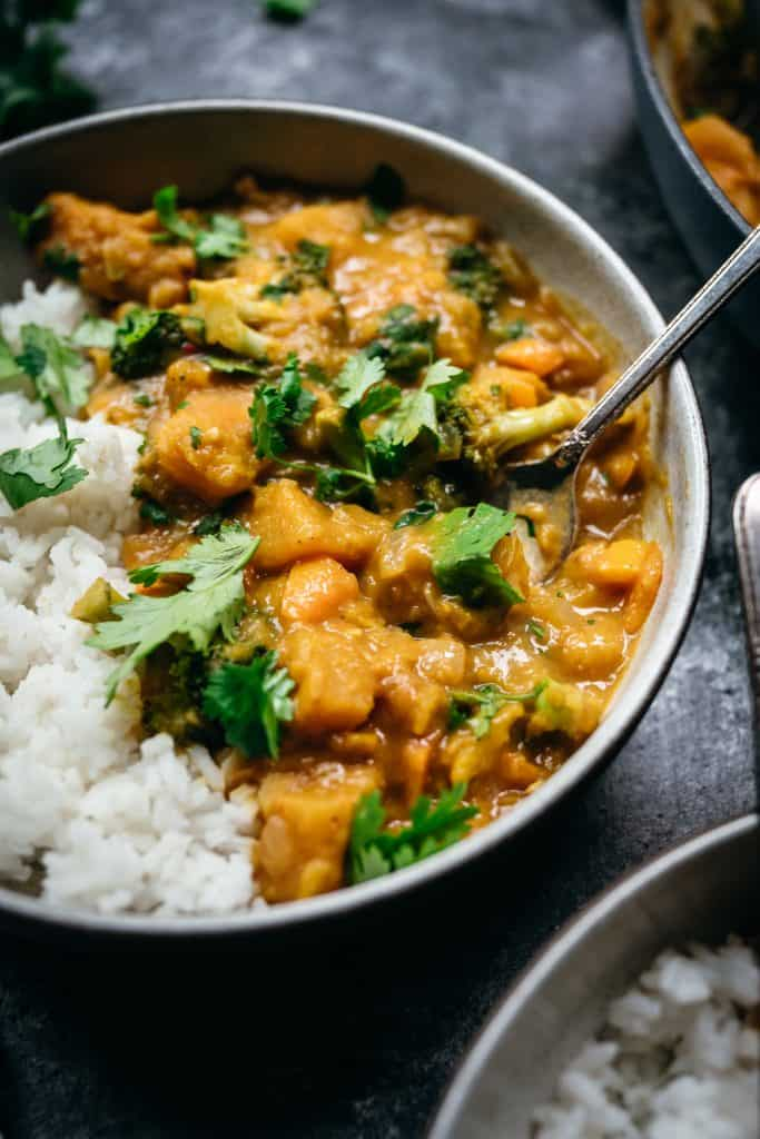 45 degree close up of vegan pumpkin curry with jasmine rice
