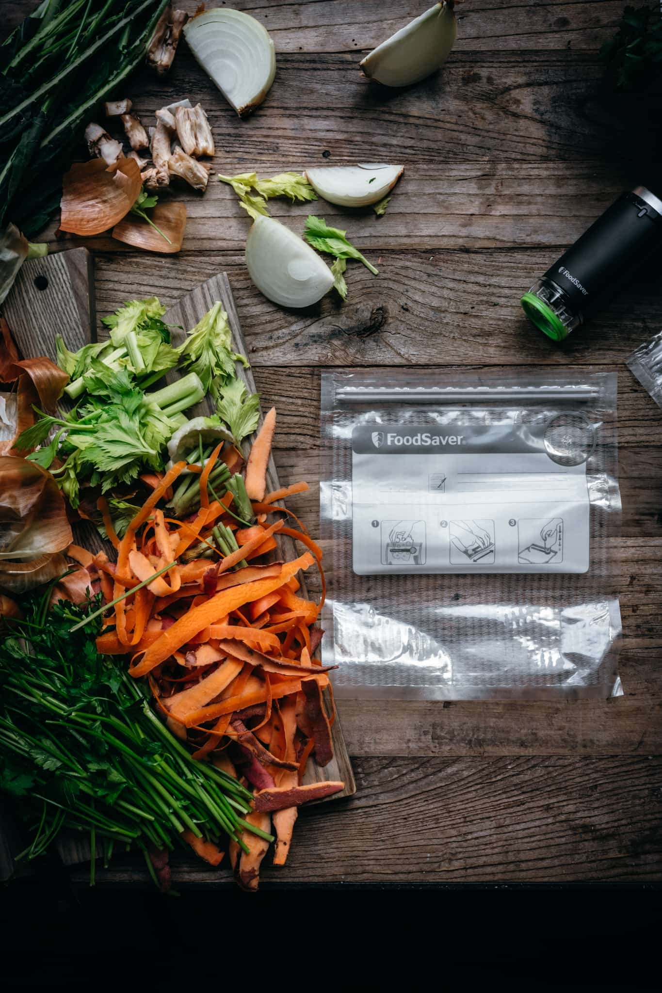 overhead view of FoodSaver vacuum sealer next to cutting tray with vegetable scraps