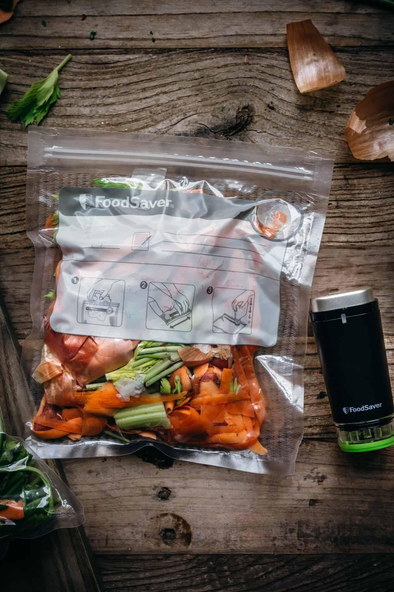 overhead view of vegetable scraps in vacuum sealed plastic bag