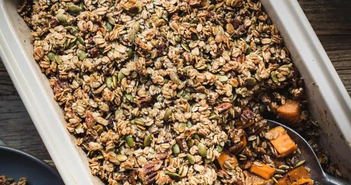 overhead view of healthy vegan sweet potato casserole with granola topping