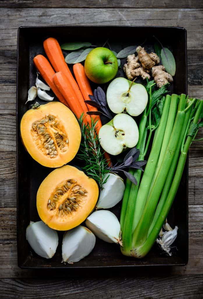 overhead view of produce ingredients for vegan carrot apple ginger soup