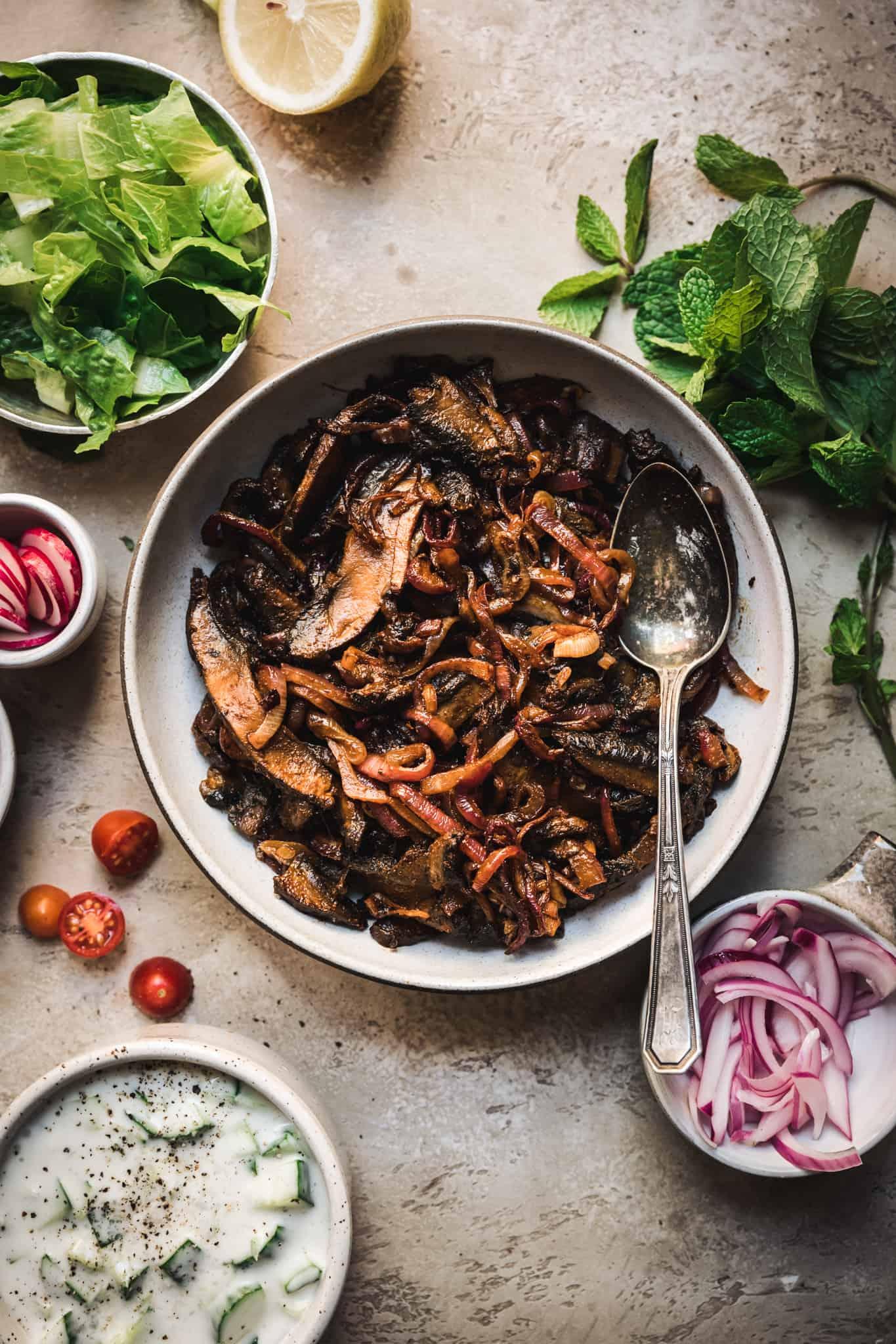 cooked vegan mushroom shawarma with seasoning in a bowl