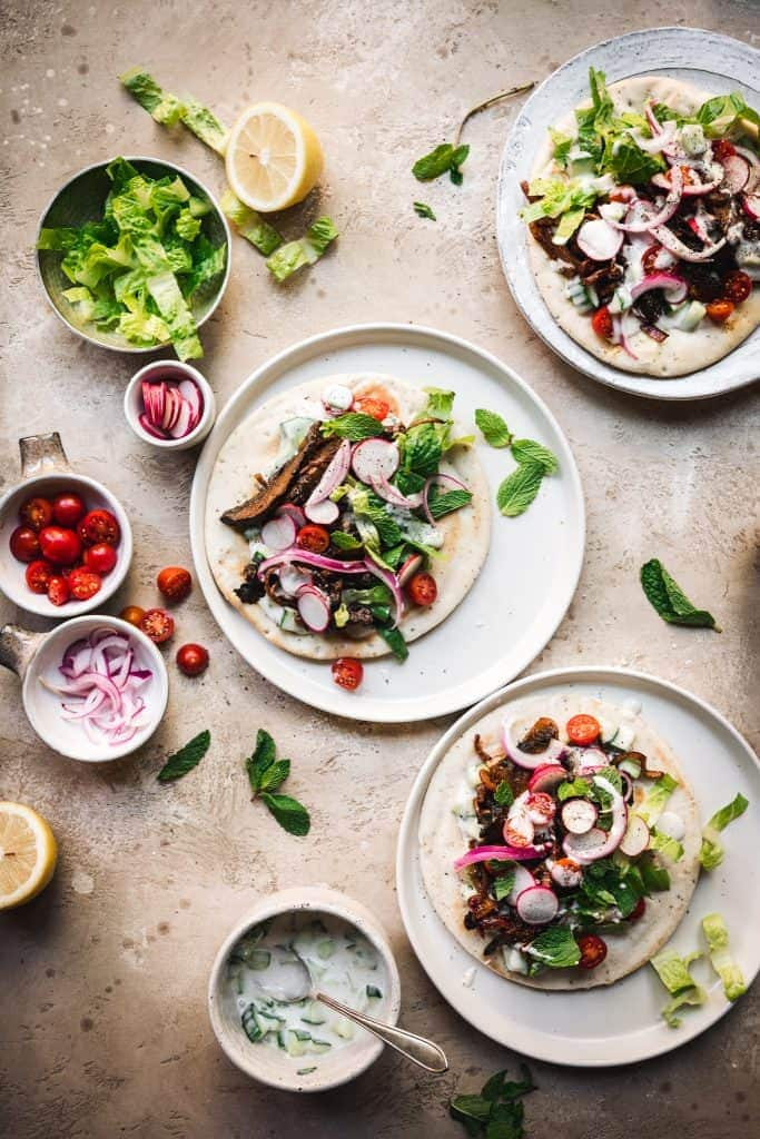 overhead view of vegetarian mushroom shawarma with vegan tzatziki on pita