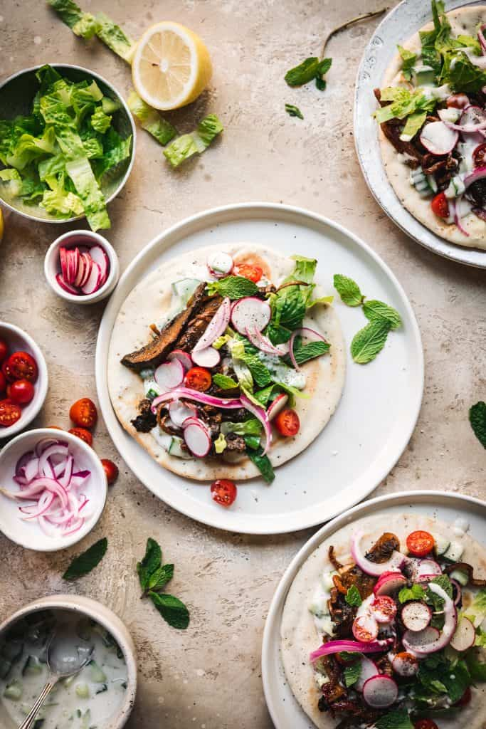 overhead view of vegan mushroom shawarma on pita with vegetarian toppings