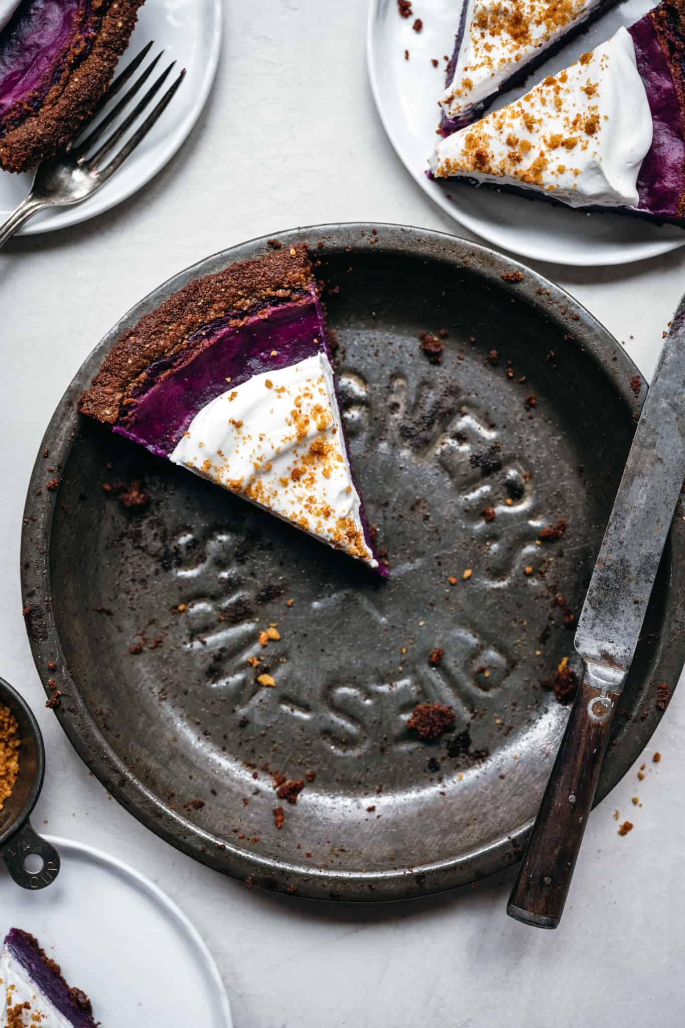overhead view of purple sweet potato pie in antique pie pan