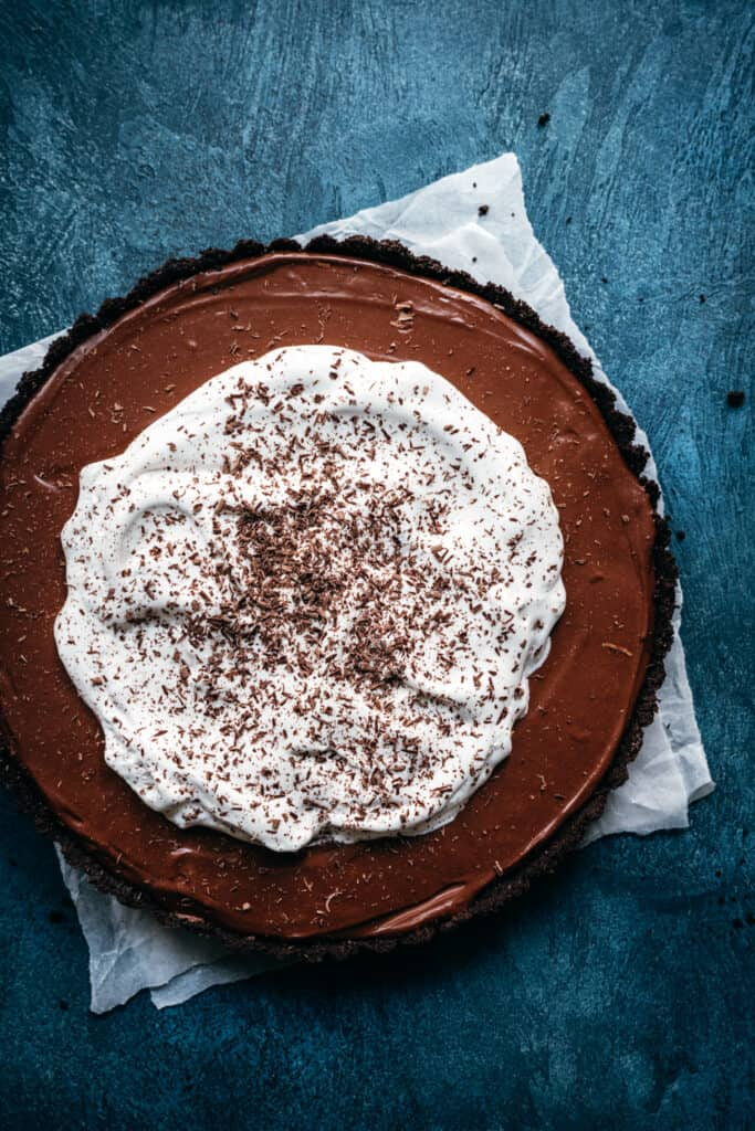 overhead view of whole chocolate pie topped with whipped cream
