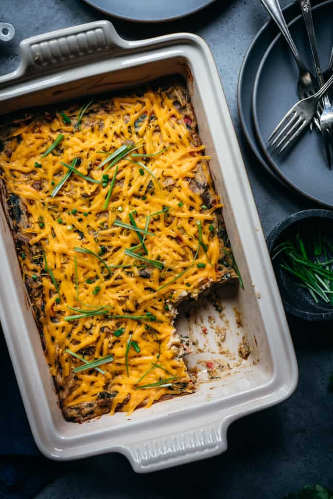 close up overhead view of vegan breakfast casserole with cheddar cheese