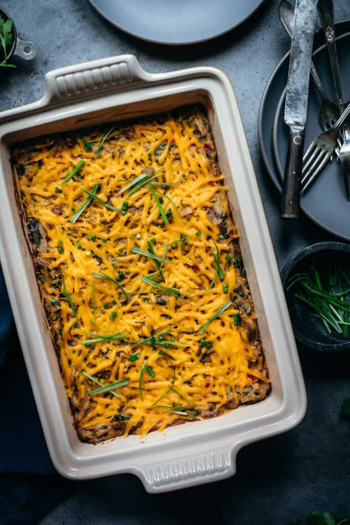 overhead of baked vegan breakfast casserole in a white baking dish