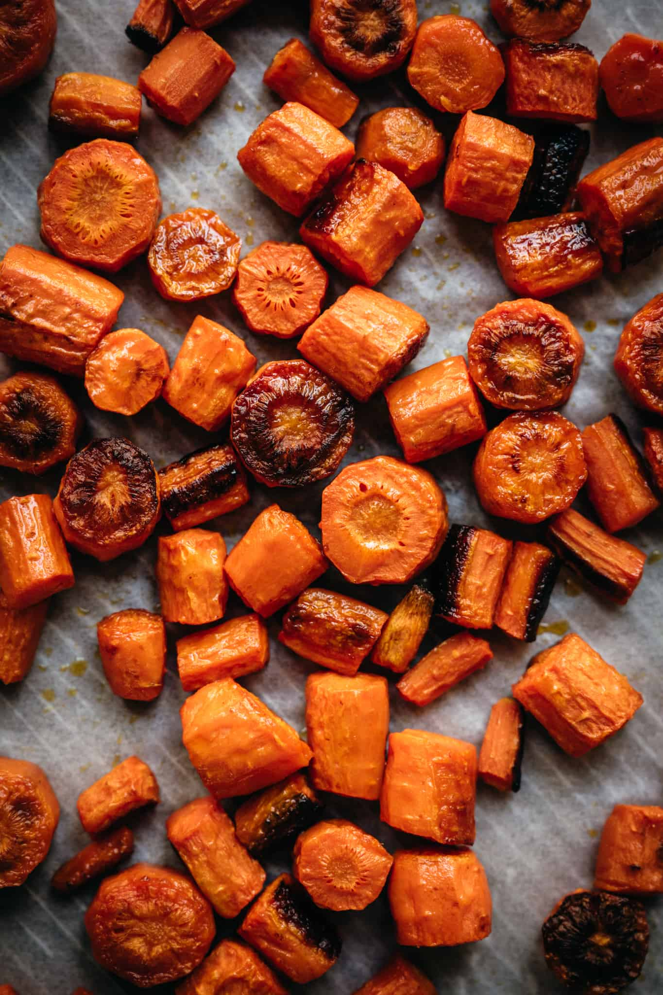 overhead of roasted carrots on a baking sheet