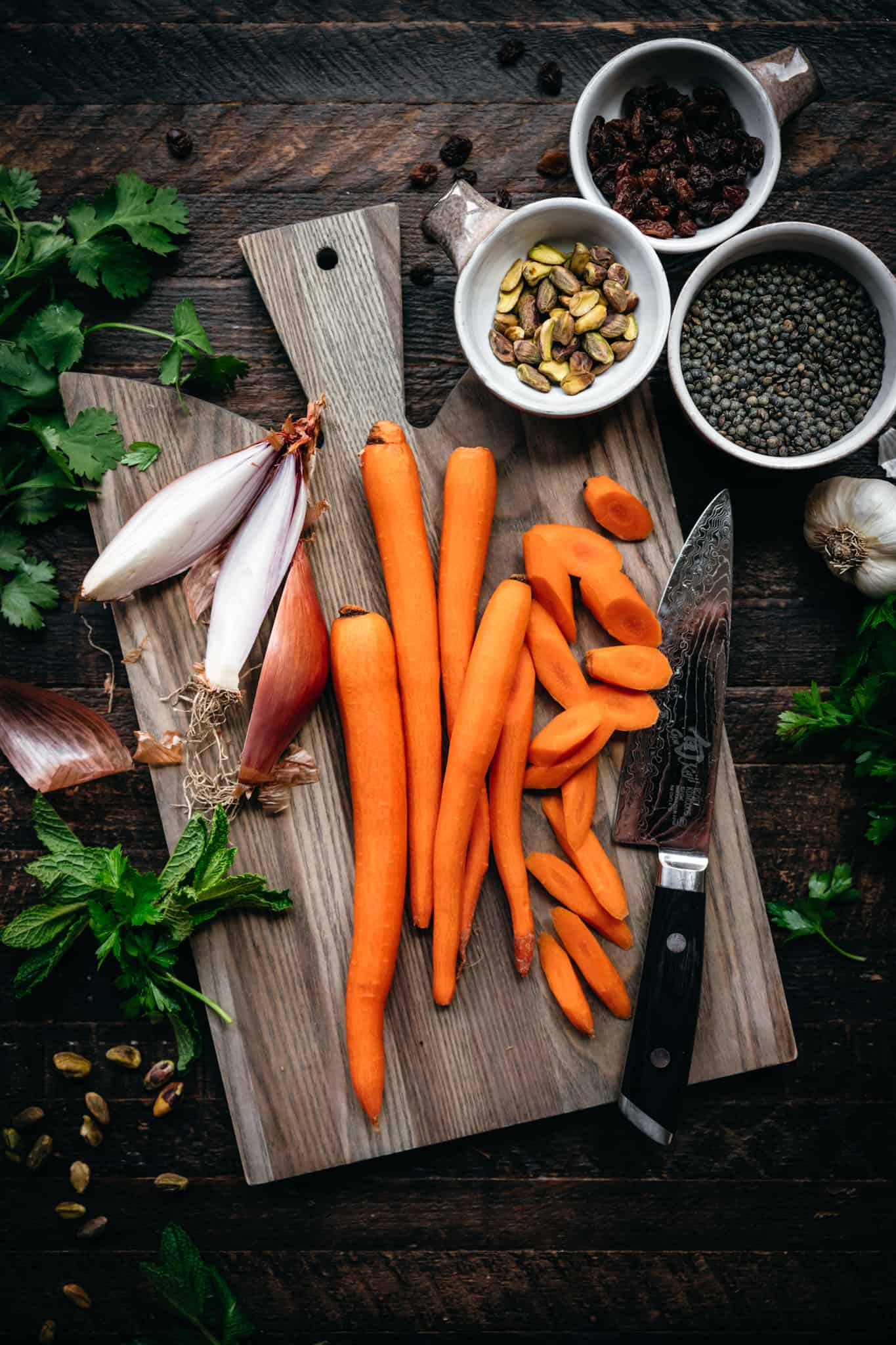 overhead view of ingredients for vegan lentil and carrot salad on cutting board