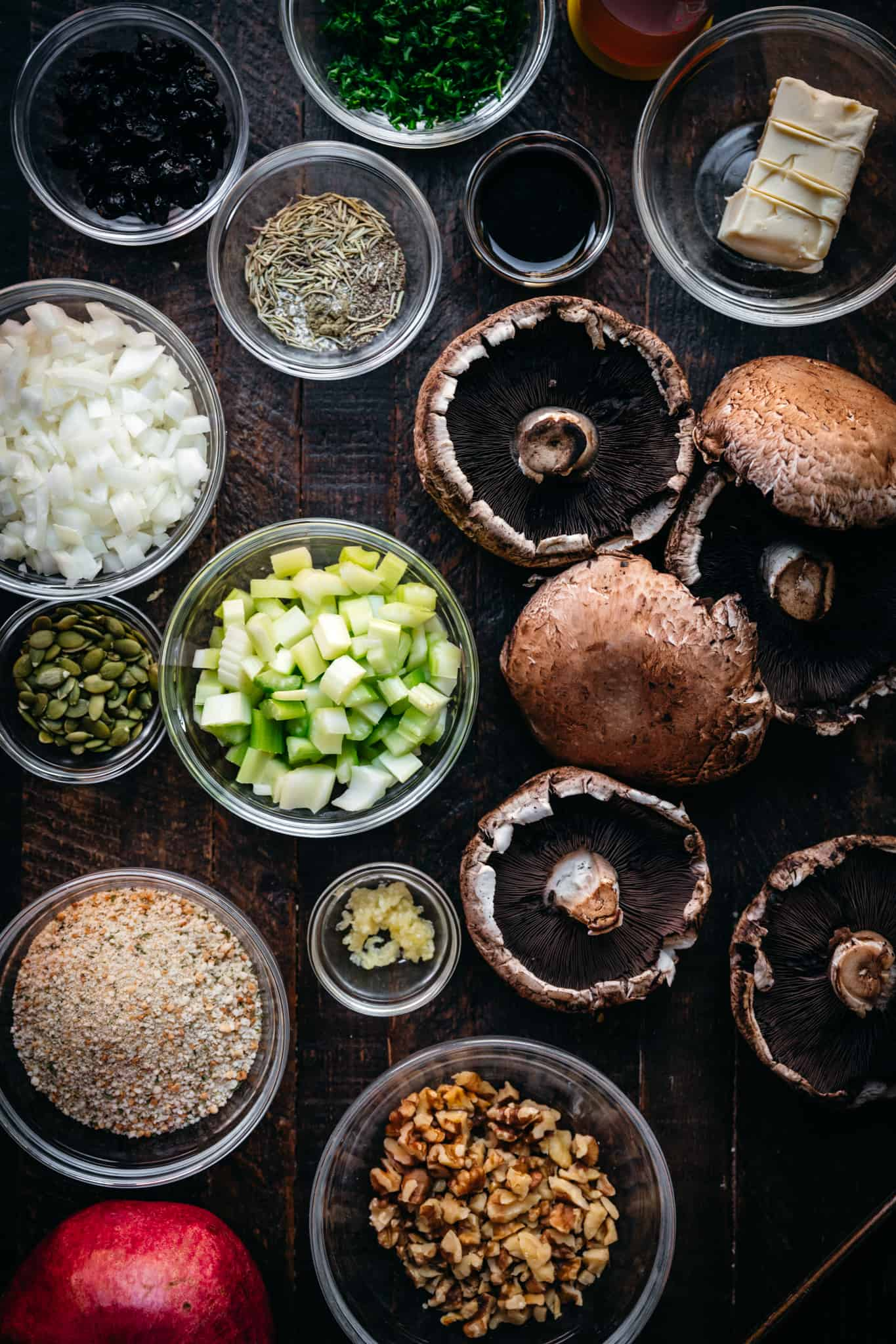 overhead view of ingredients for vegan stuffed portobello mushrooms on wood surface