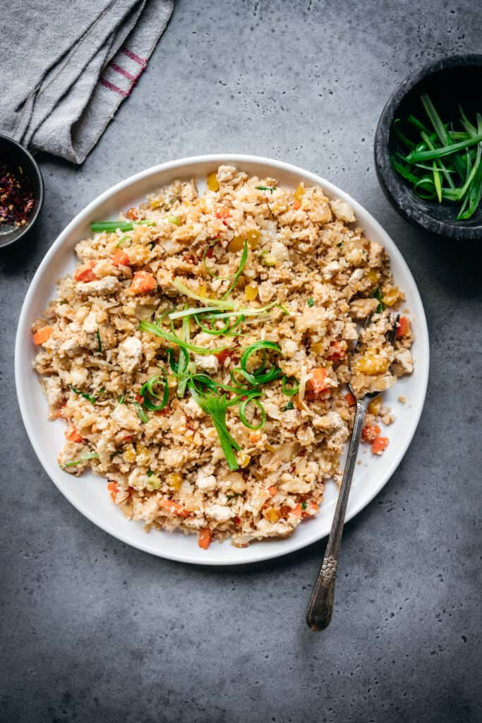 overhead of vegan cauliflower fried rice on a white plate