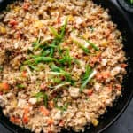 overhead of vegan cauliflower fried rice in a cast iron skillet
