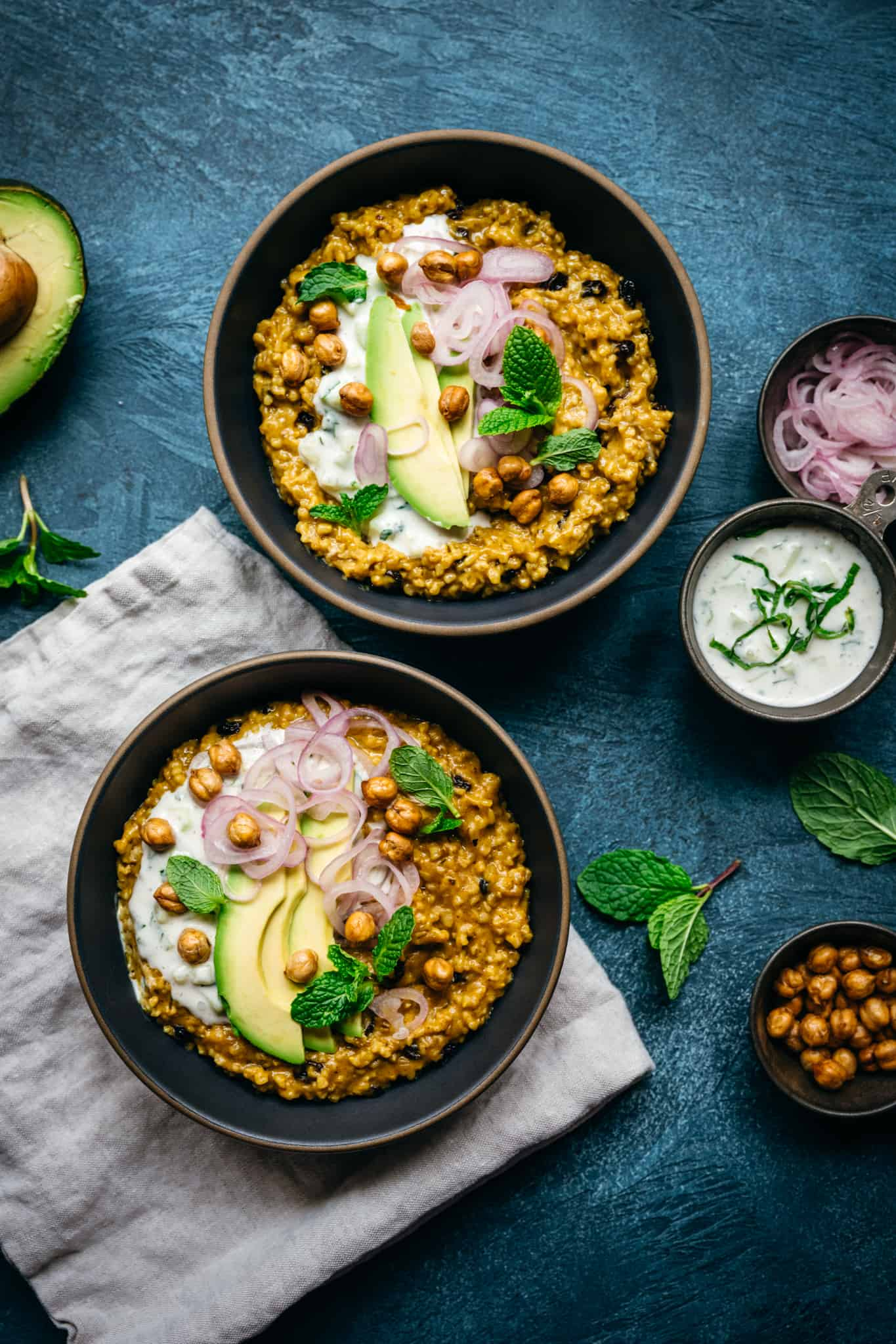 overhead view of two bowls of savory steel cut oats