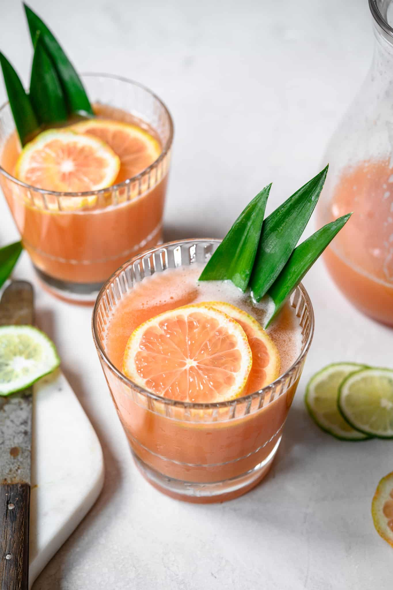 side view of two guava rum cocktails