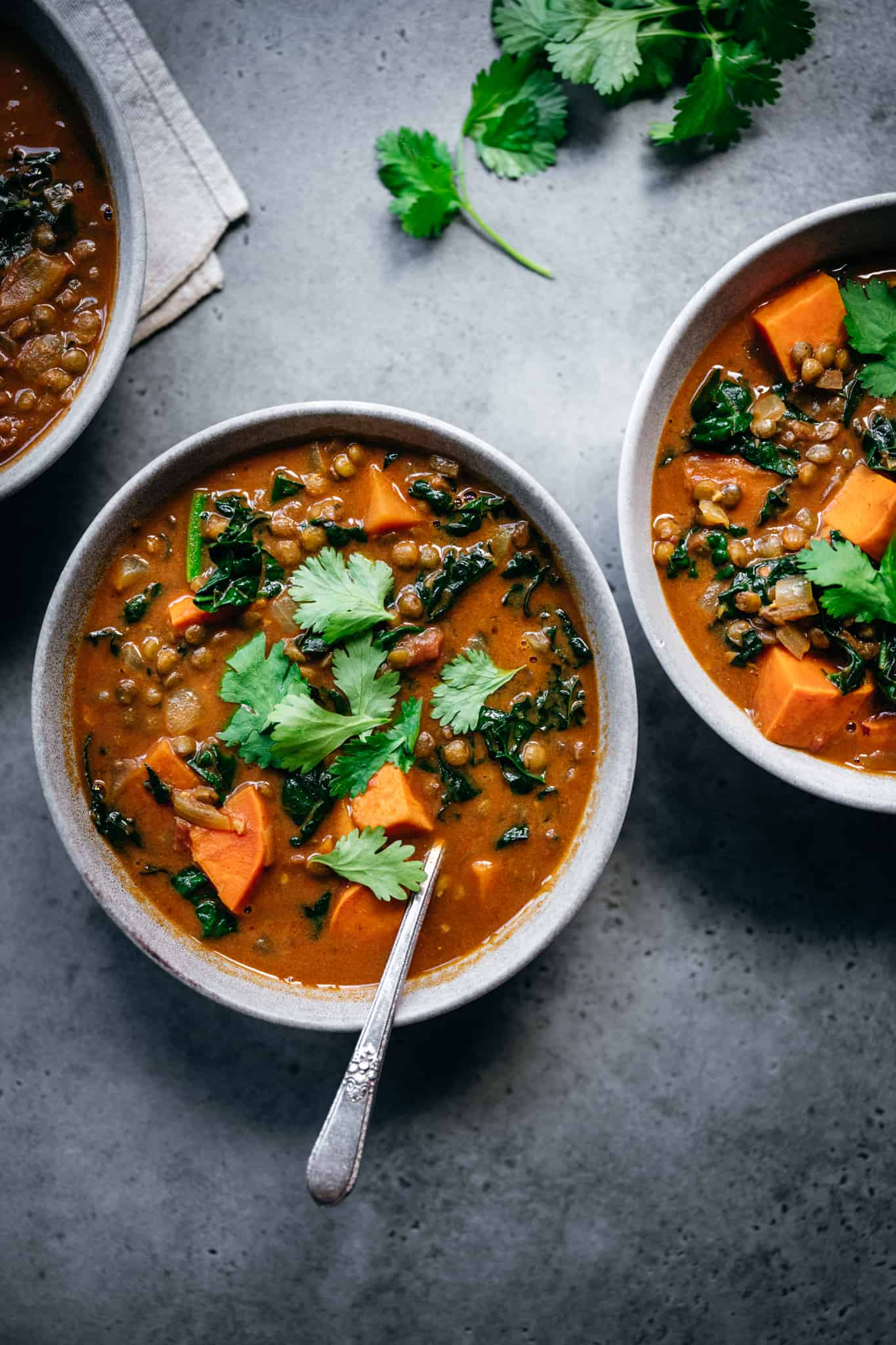 vegan lentil curry sweet potato soup in two bowls
