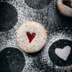 One linzer cookie with a heart seen from above.