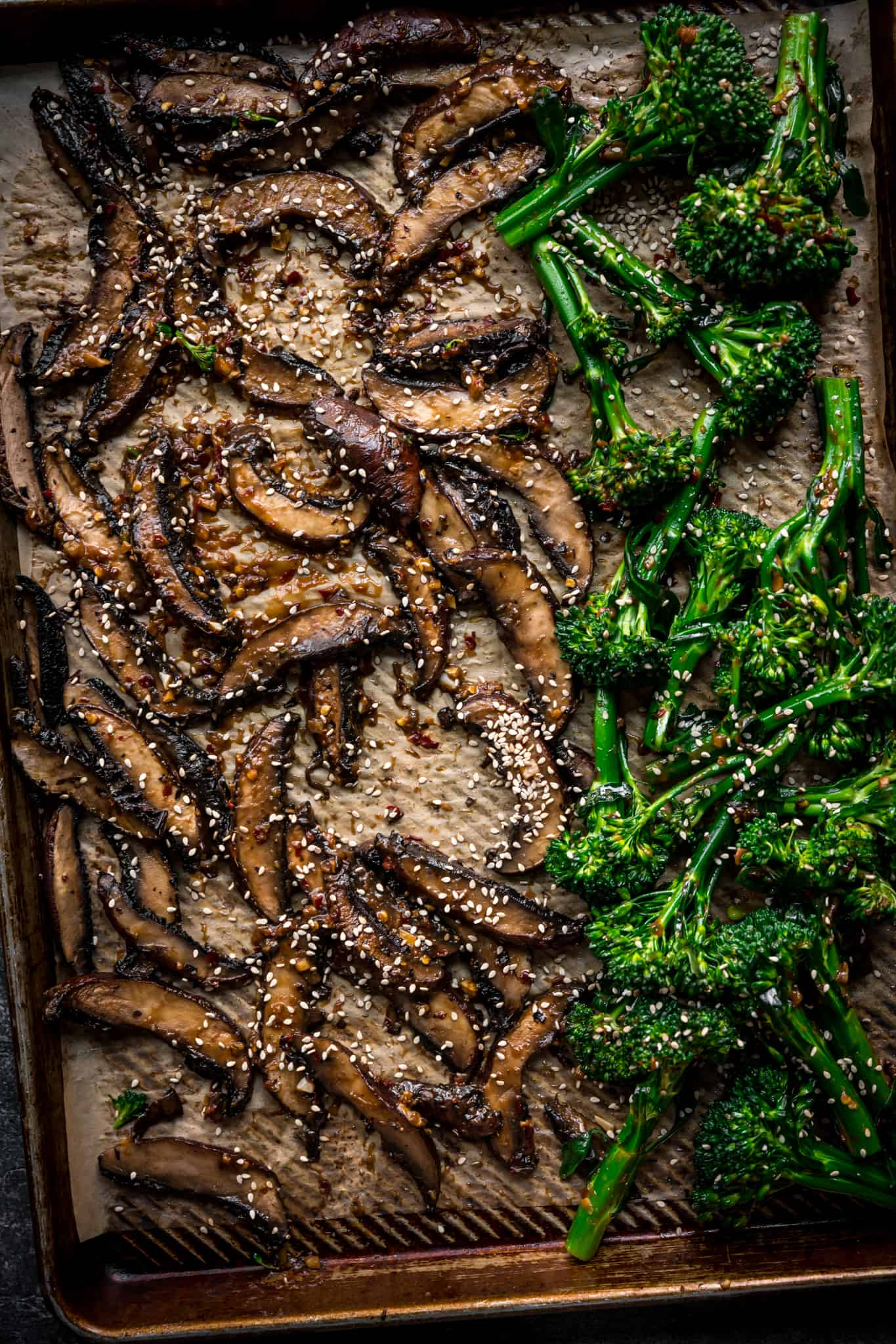 overhread of a sheet pan with mushrooms and broccolini
