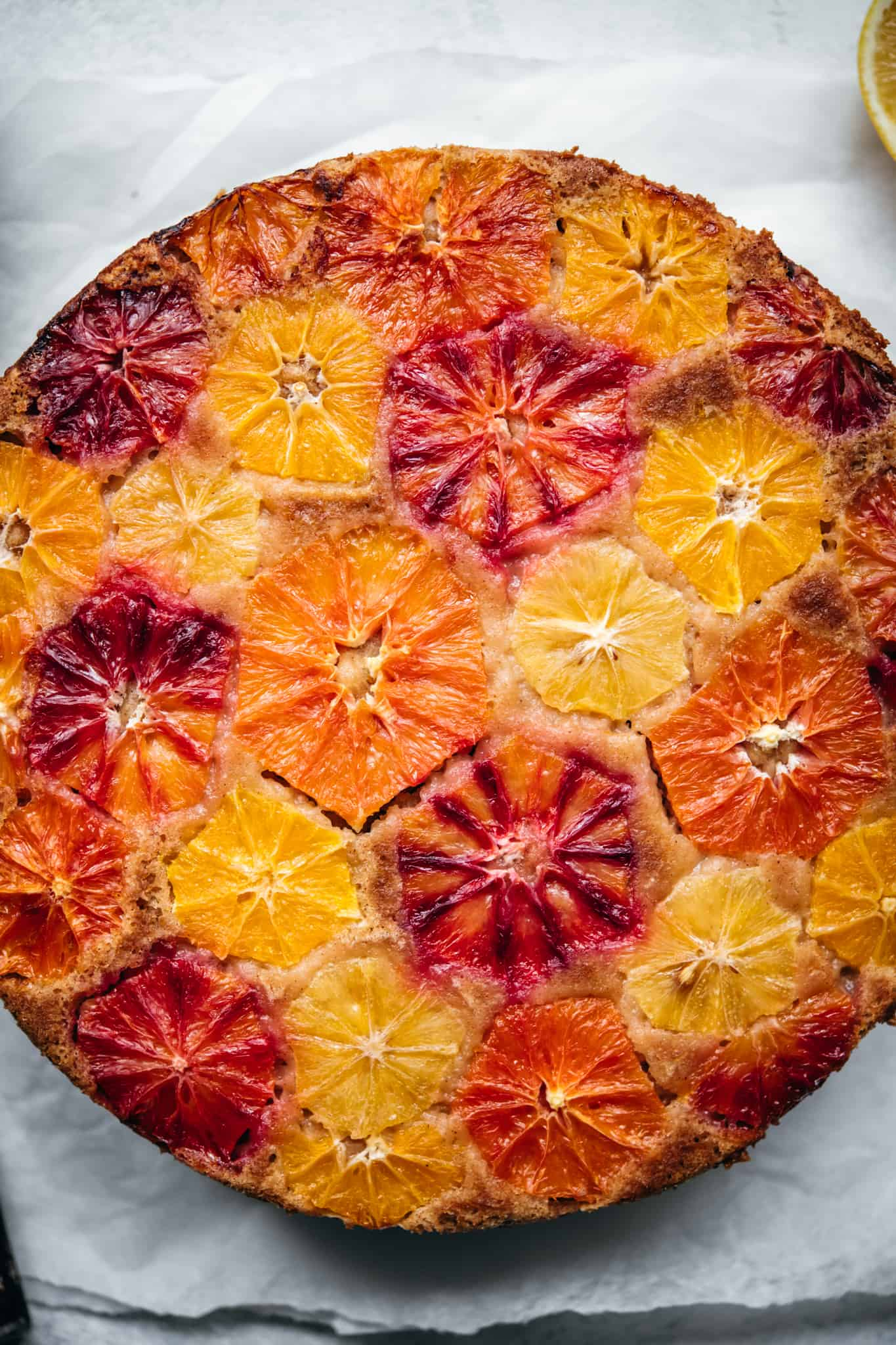 close up overhead view of baked orange olive oil cake