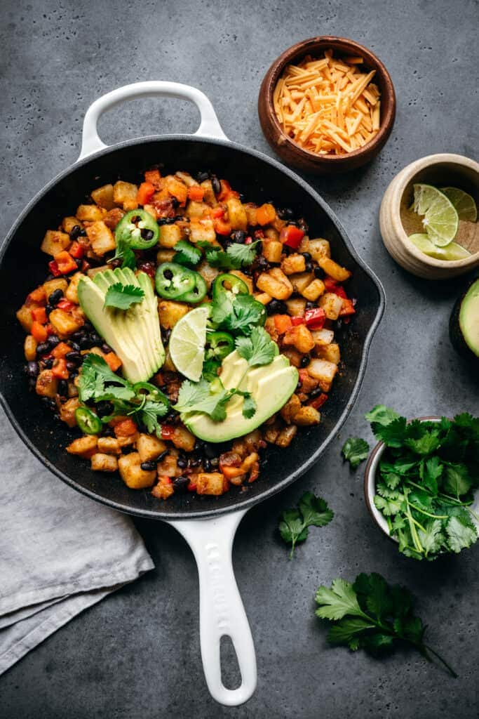 overhead view of vegan breakfast skillet with potatoes and black beans