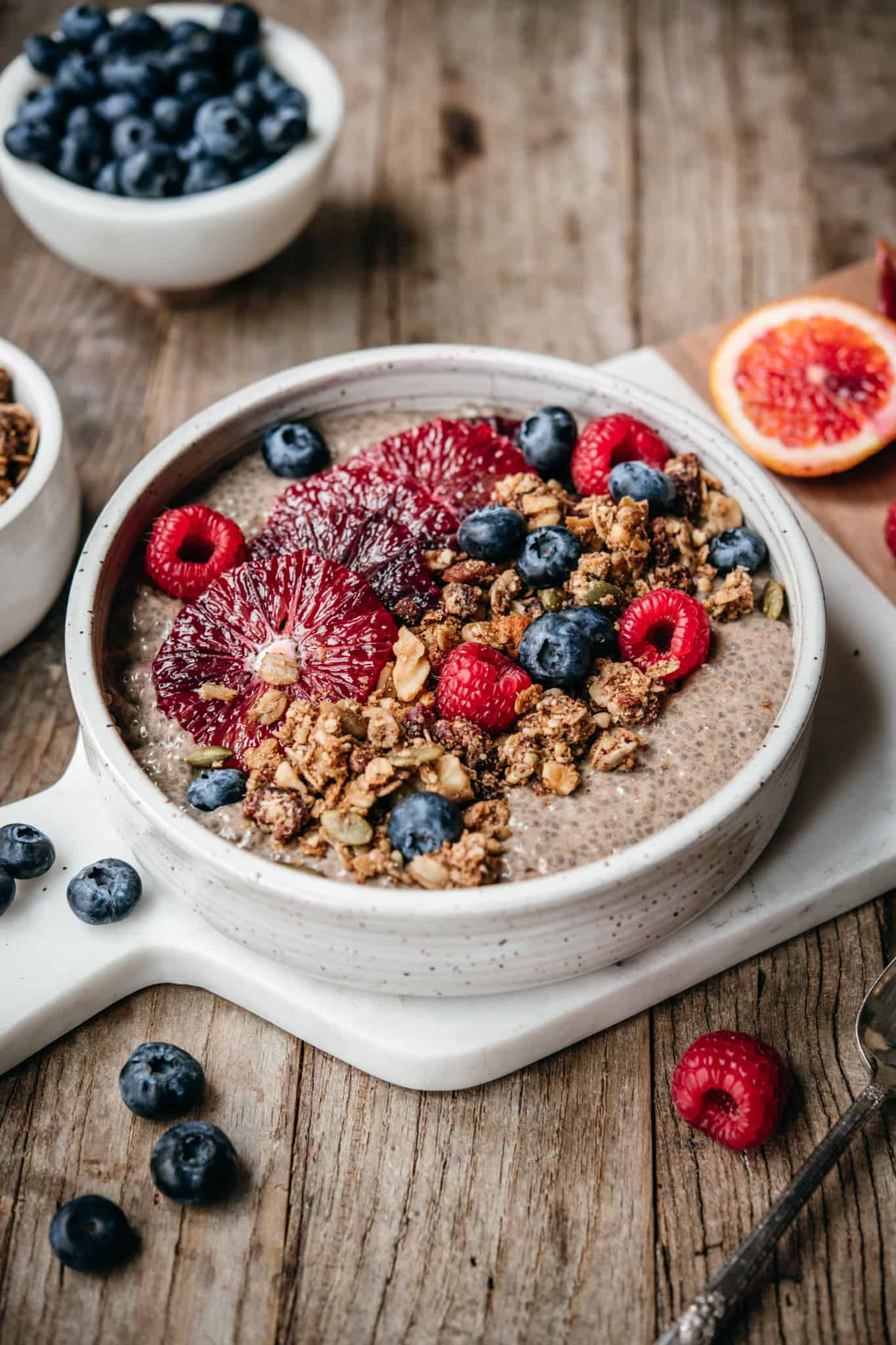 side view of chai spiced chia pudding in bowl with teff granola