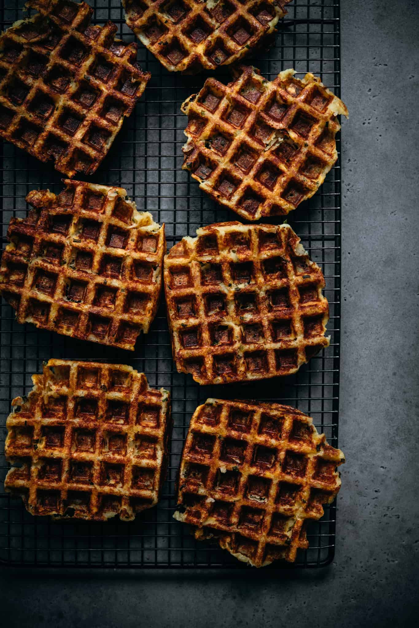 overhead view of crispy mashed potato waffles on cooling rack