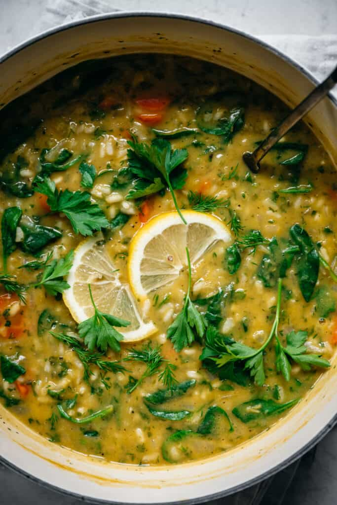 close up view of vegan lemon rice soup in large pot