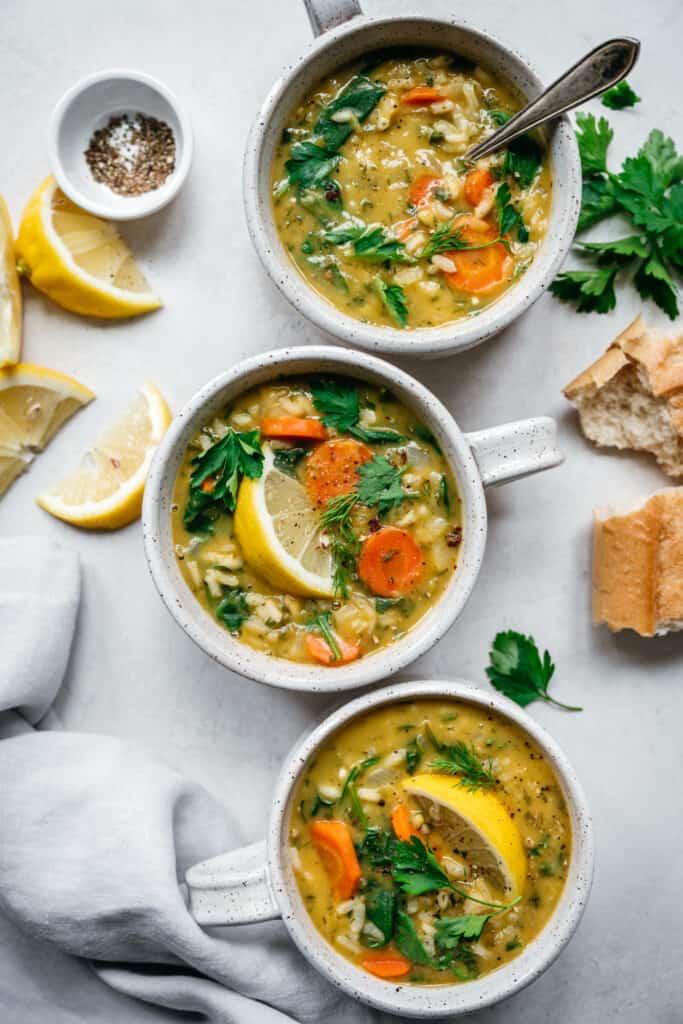 overhead view of vegan lemon rice soup in soup bowls