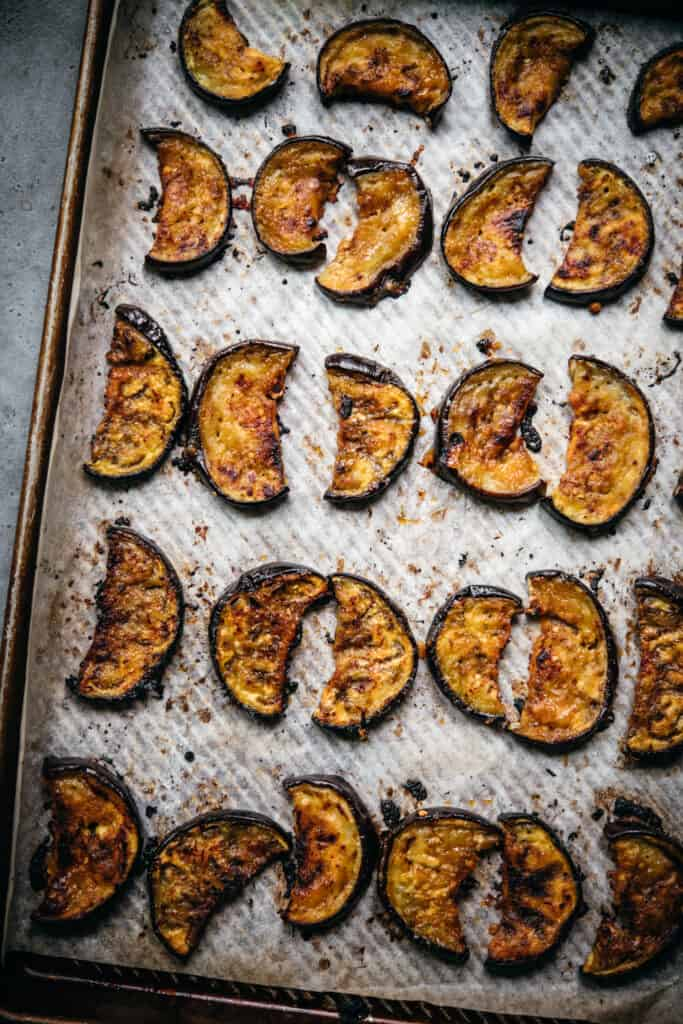 overhead view of miso glazed oven roasted eggplant slices on sheet pan
