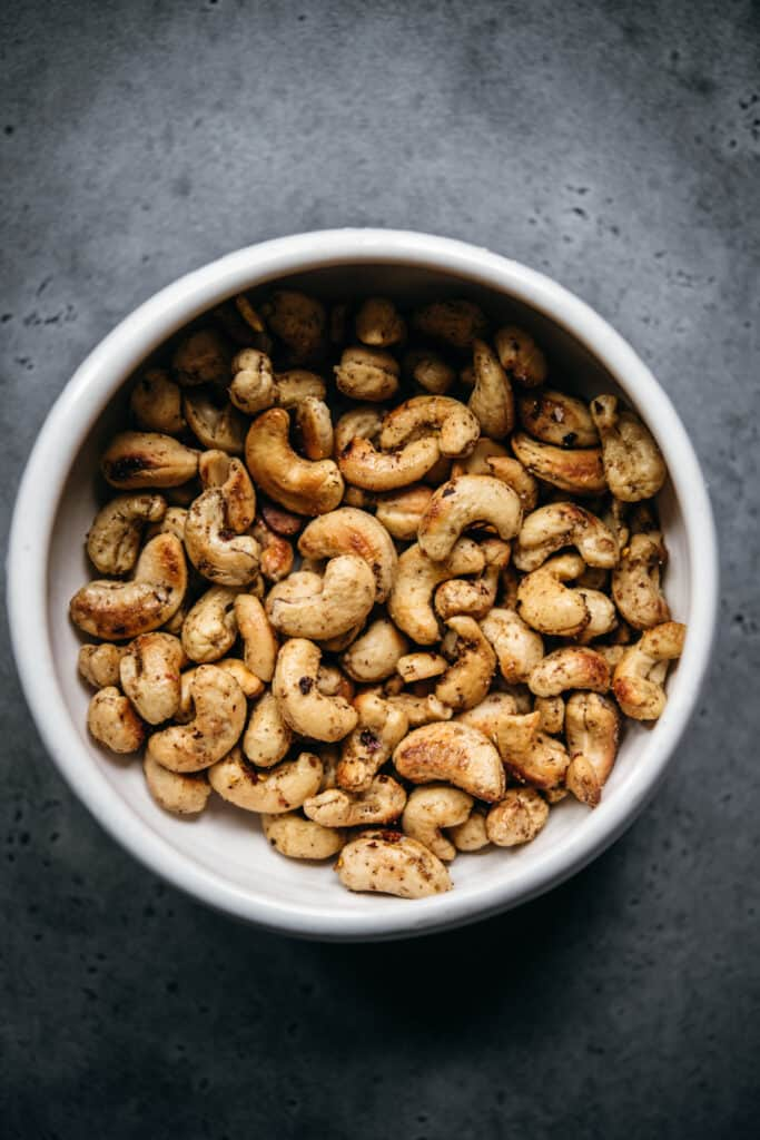 overhead view of bowl with chili garlic cashews