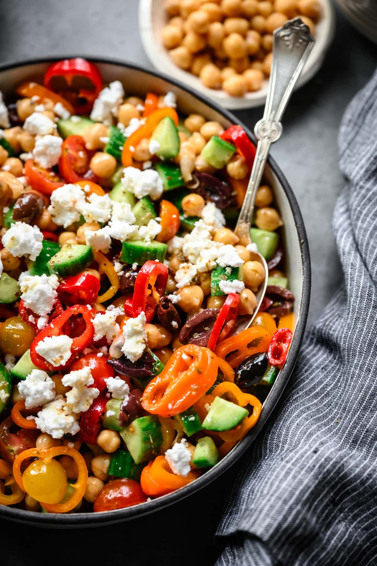 close up overhead view of vegan greek chickpea salad in bowl