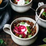 Pinto bean chili seen from above in a cup.