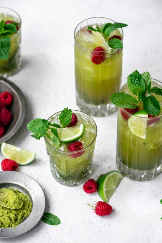 side view of matcha mojitos in highball glasses
