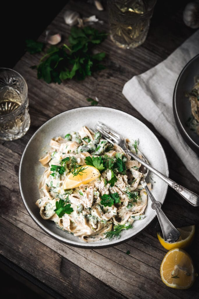 overhead view of vegan lemon asparagus pasta in bowl with fork