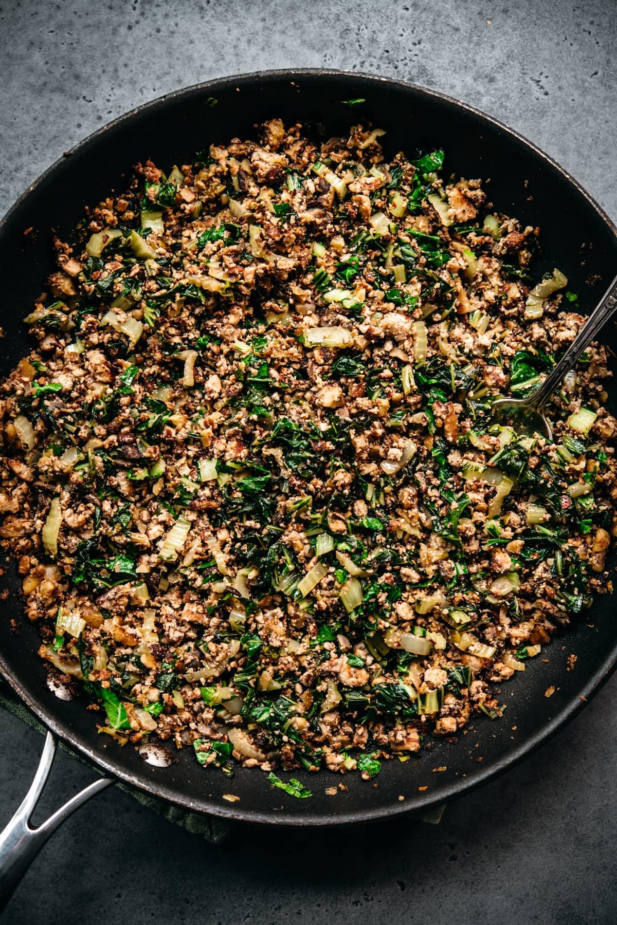 overhead view of vegan tofu, mushroom, walnut meat mixture in pan