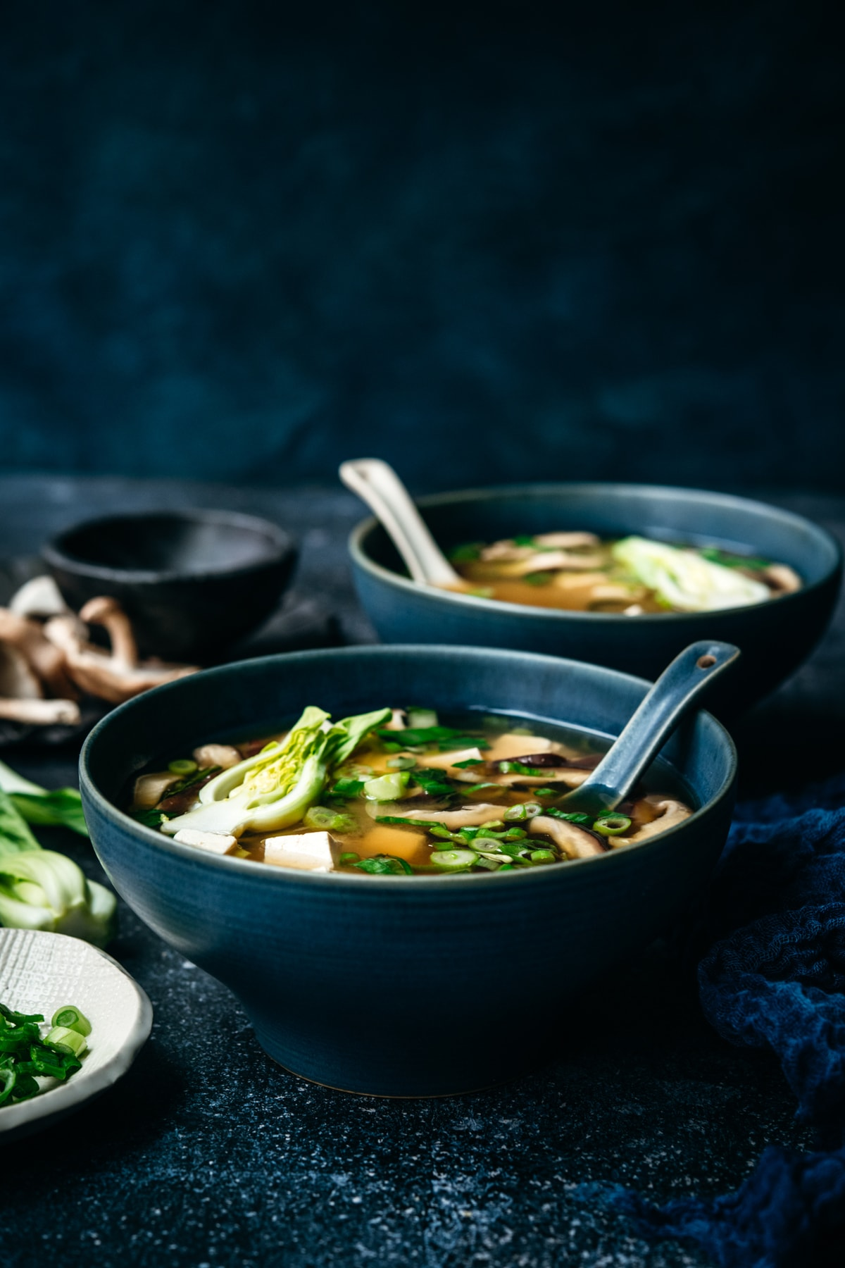 side view of vegan miso soup in blue soup bowl